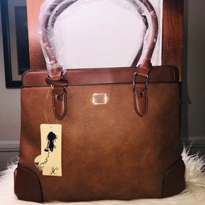 Jolene Couture.  Bags Brown bag with quite